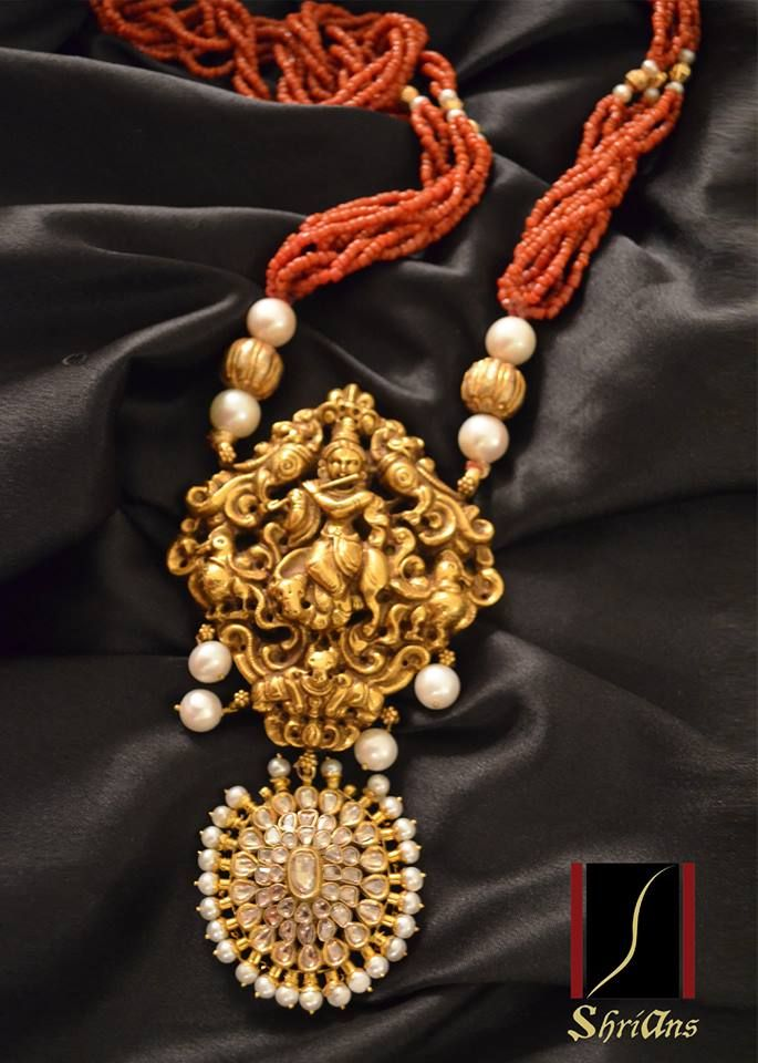 An attractive pendant from Shrians with detailed carving of Lord Shri Krishna. Undoubtedly an auspicious addition to every woman's jewelry collection crafted in 22 kt gold along with a diamond polki pendant.
