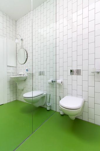 Vert Pomme Dalsouple rubber flooring installed in a bathroom in a 100 year old house in Fitzroy, Melbourne, Australia. Photographer, Nic Granleese.