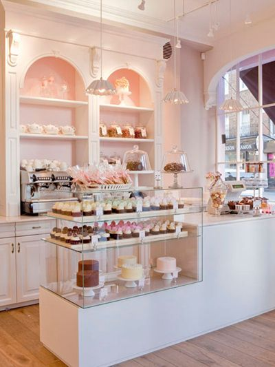 The glass case that stores cupcakes , cakes , pastry in the glass so the people have a clear view of the food!