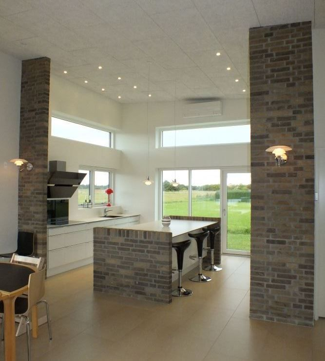 Rå mursten skaber kontrast i dine rum, således at du får skabt et unikt look.