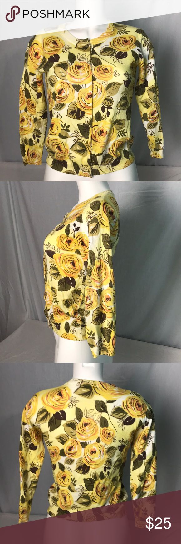 "CAbi 465 Yellow Floral Snap Front Jo Cardigan Chic yellow rose cardigan with various green leaves. Snap closures. Arm pit to arm pit across the front is 17"". Length from shoulder 22"". Sleeve length 18"". 80% cotton 20% spandex. CAbi Sweaters Cardigans"
