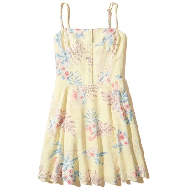 Hollister Button-Front Skater Dress ($50) ❤ liked on Polyvore featuring dresses, yellow pattern, yellow skater skirt, beige cami, strappy cami, flared skirt and circle skirt