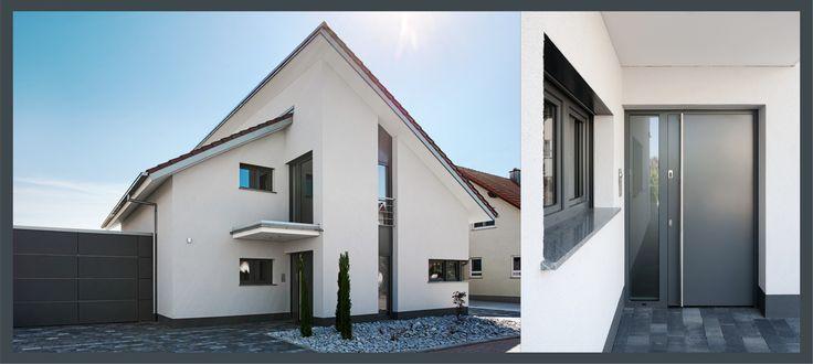 Die Gestaltung dieses Einfamilienhauses gewinnt durch die Bauelemente in kontrastierendem Grau. Die Haustür mit integrierter, modernster Sicherheitstechnik unterstreicht den technischen Look.
