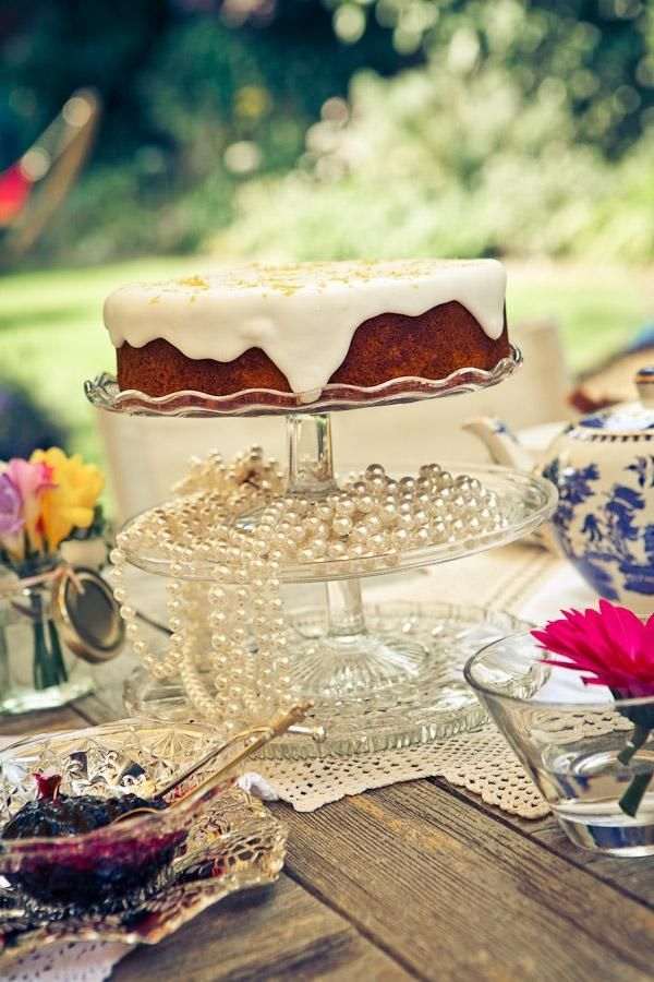 Vintage Afternoon Tea with peals and lace on an old picnic table is a charming tablescape in a world of TeaCup Living. Serve on!