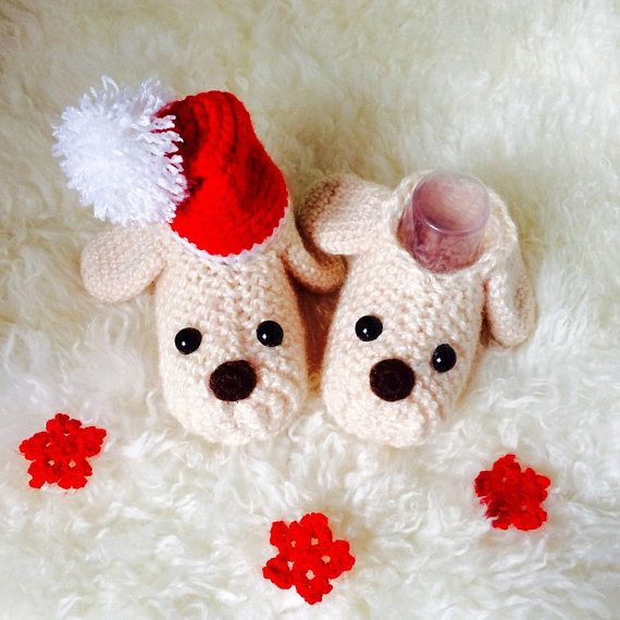 Puppy knitted baby booties symbol of the 2018 year Puppy