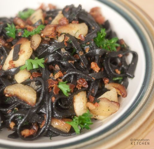 Squid ink pasta with pancetta and parsnips