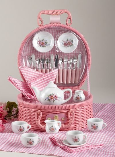 Tea set in a pink basket. I would love to get this for my little girl.