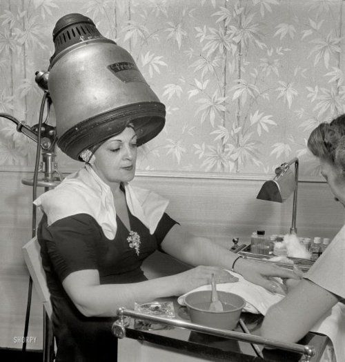 "American Beauty: 1942  September 1942. ""New York, New York. Getting a manicure while drying hair at Francois de Paris, a hairdresser on West Eighth Street."" Medium format nitrate negative by Marjory Collins for the Office of War Information.: Eighth Street, Beautiful Shops, Paris, Dry Hair, Beautiful Salons, Hair Dryer, New York, Francois De, Beautiful Parlor"