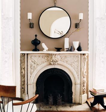 A quiet grace in the living room, captured by Domino magazine. That mantle is unreal!: Decor, Fire Place, Round Mirrors, Interior, Fireplaces, Living Room, Design
