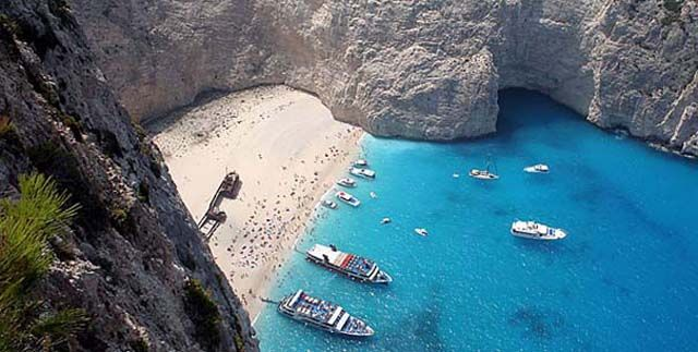 Navagio, Zakynthos  The most-photographed beach in Greece where a famous shipwreck is the star attraction for visitors who want an authentic castaway experience.