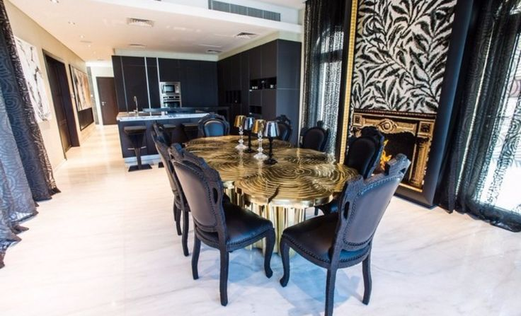 The Luxury Dining Table In The Saadiyat Private Residence | www.bocadolobo.com #moderndiningtables #diningtables #diningarea #diningroom #thediningroom #luxurious #luxury #gold #exclusivedesign #interiordesign #topinteriordesigners #bestinteriordesigners #famousinteriordesigners @moderndiningtables