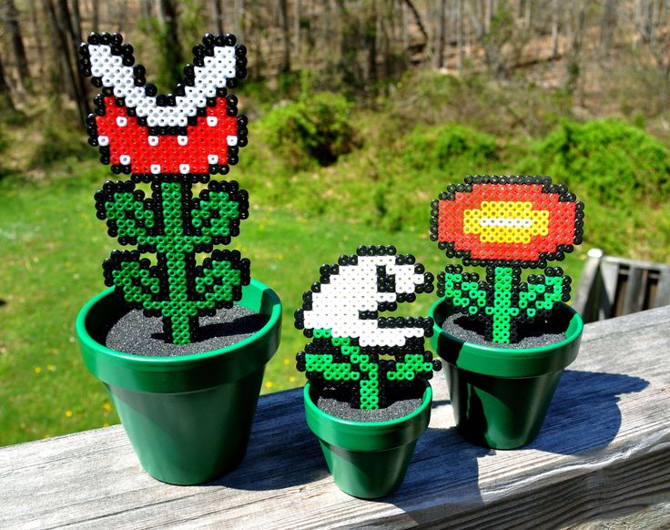 """I made a set of these earlier to go towards a charity auction to benefit those affected by the recent disasters in Japan. They were so fun and easy to make that I think I'll be making a few more!:) Made with perler beads, painted pots, model magic (to """"fill"""" the pots), and covered…"""