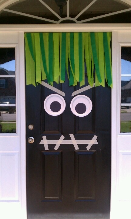 My Halloween monster door!  Green streamers, 2 paper plates, black construction paper (pupils), and masking tape.  SO simple & my kids love it!  They want to leave it up all year.  LOL