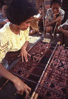 Woman displays Ikat weaving