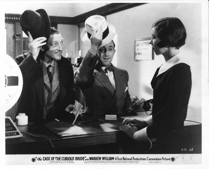 Warren William as Perry Mason, Allen Jenkins as Spudsy Drake, Mary Treen as Telegraph Office Clerk in The Case of the Curious Bride (1935). From the Jim Davidson Collection.