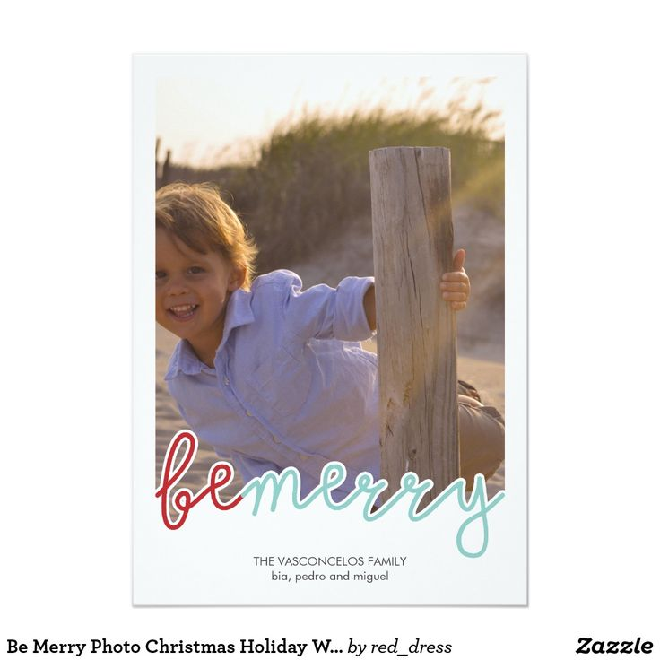 "Be Merry Photo Christmas Holiday Wishes Red Blue Card Be Merry photo cards featuring the words ""be merry"", in red and blue whimsical font (with cut out text, on white background), and one photo template with little boy playing in the beach. The back of this Be Merry Christmas card features a simple striped design, with a red and white diagonal stripes pattern. Easily make personalized Christmas cards for family, with your own text and favorite pictures."