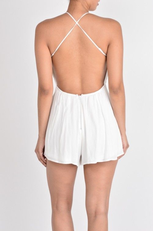 Made of 100% Polyester the top of this romper has thin straps that makes an x-cross on the back. It is backless. The front bodice as a V neck with scallop edges. The shorts is made of 100% Rayon.and with zipper as closure.