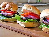 Grilled Portobello Mushroom Burgers courtesy of Food Network - perfect for a vegetarian summer cookout! Even meat-eaters will enjoy this satisfying meal :)