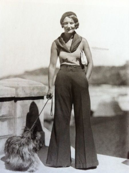 Girl walking her dog, French Riviera, 1920s.