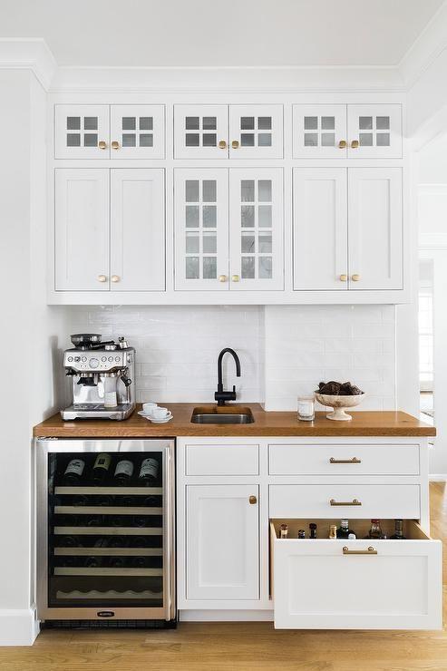 Gorgeous white kitchen wet design with wooden countertop + brass hardware + subway tile backsplash   Cummings Architects