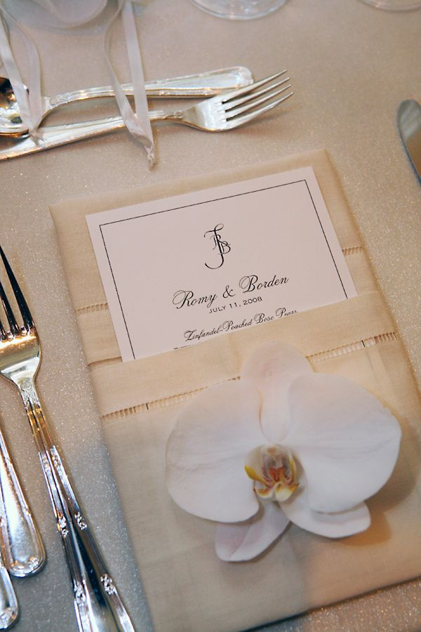 Ivory place card with ribbons and white