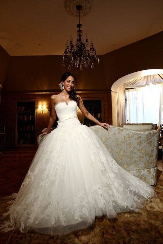 Danielle Deleasa's strapless tulle Vera Wang ballgown features floating chantilly lace detail. Vera Wang gowns are sold at The Bridal Salon at Saks Jandel.