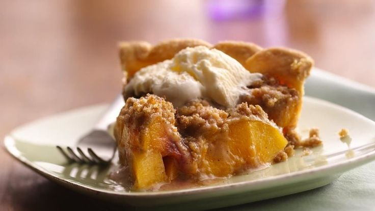 Looking for a delicious dessert? Then check out this mouth-watering peach pie made with Pillsbury® refrigerated pie crust, topped with cinnamon streusel.