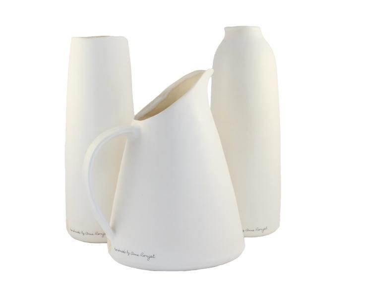 White ceramic earthenware jug, pourer and vase