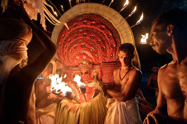 Theyyam is a popular ritual art of south India(kerala),It is rich in culture and is essentially a dance festival.In Theyyam people worship deity and dancer is also the deity. In this art devotees worship Mother Goddess. Though animals, serpents and trees are also worshiped by many.