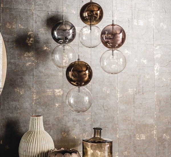 Apollo is a suspension lamp designed by Oriano Favaretto for Cattelan Italy, made of borosilicate glass, chrome-plated steel ceiling attachment. Apollo has a simple and charminglydesign; pairs of balls in which the lower sphere is in transparent glass and the upper ball is painted chromium, copper, bronze or transparent.Apollo is available with single suspension lampshade both transparent; with five suspensions having superiorlampshades:twochromium, two copper and one transparent; eight…