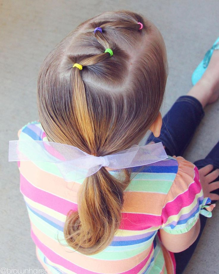 Zig zag elastics into a side ponytail.  I did this style a long time ago…one of my favs.