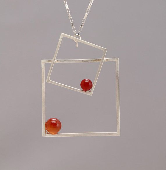 Fabricated with sterling silver square wire and half drilled Carnelian stone. Hangs from a 20 sterling silver venetian box chain and a hand