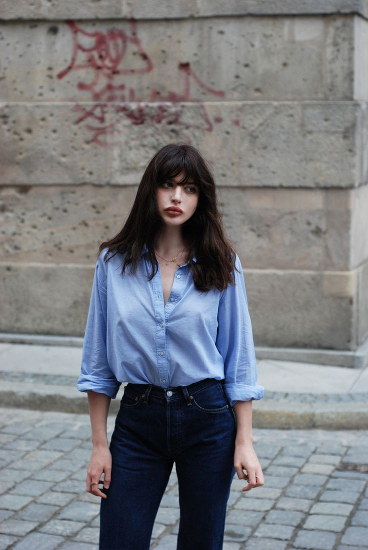 Light blue shirt goes well with dark denim, possibly this shirt with a dark denim dungaree dress