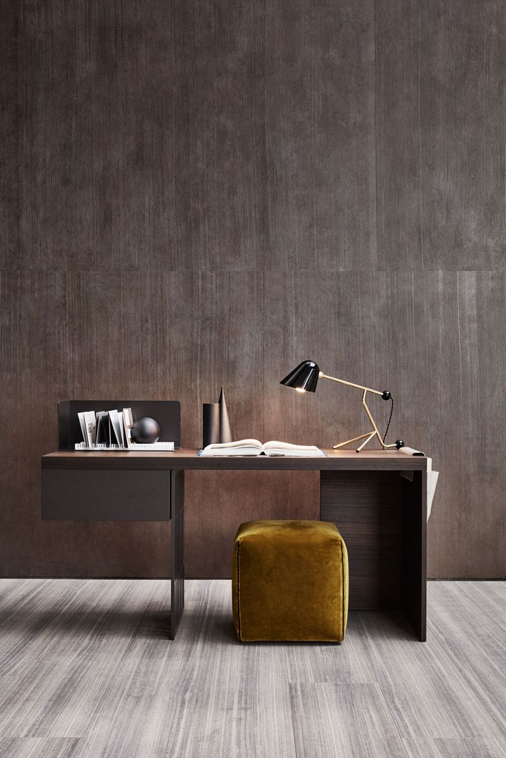 A desk with very clean lines and a decoratively perforated top support element that conveys a sense of lightness.