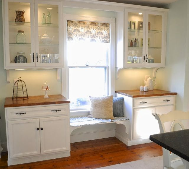 Love this storage/bench around the window in a kitchen. Perfect for serving ware if you don't have a butlers pantry.