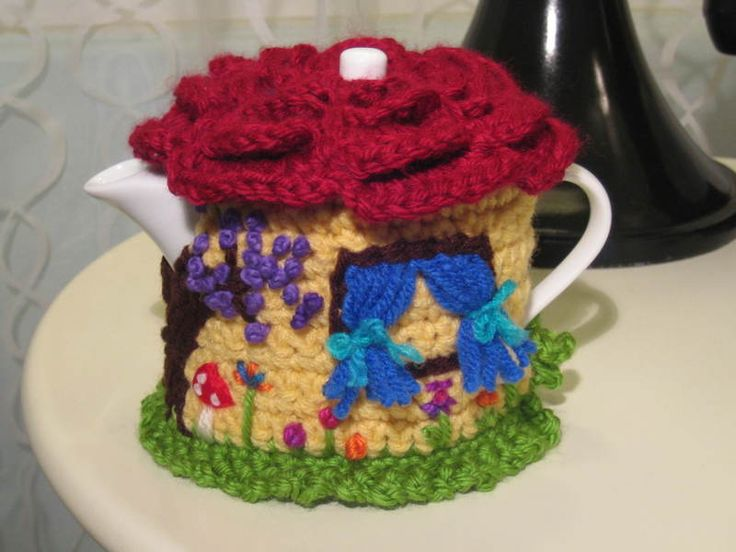 I'd love to make a tea pot cozy like this cute one, I love the detail.