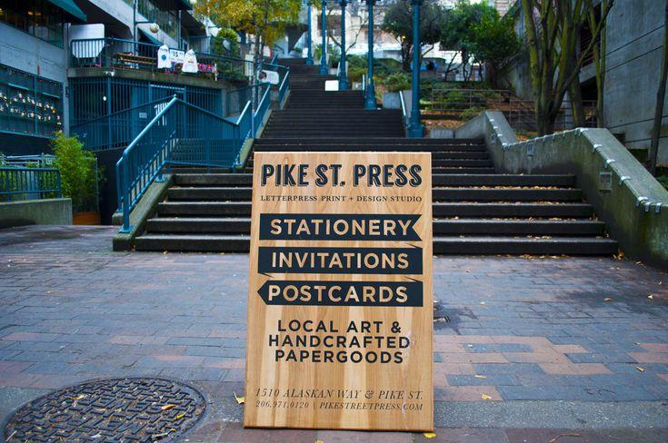 wood sign sandwich board seattle pike street press pike hillclimb