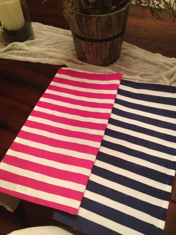 I painted white linen napkins pink and navy stripes using painters tape and acrylic paint with textile medium ( turns any acrylic paint into fabric paint).