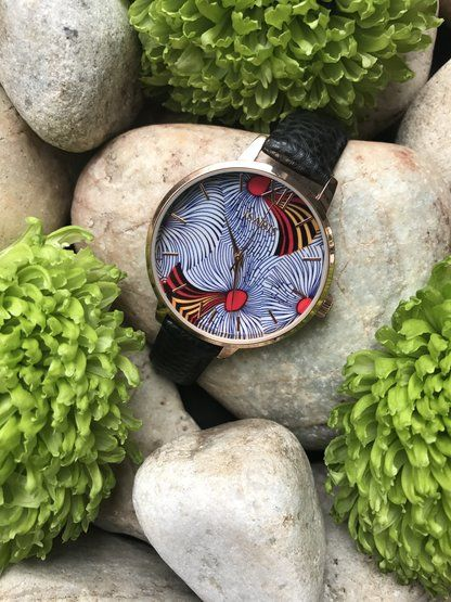 Spiral African Print Watch by ISABIS WATCH. spiral faced, pineapple leather strap, 100% Vegan. Oversized dial watch. This timepiece is a real showstopper. Feminine, watch for her. Vintage dutch wax print