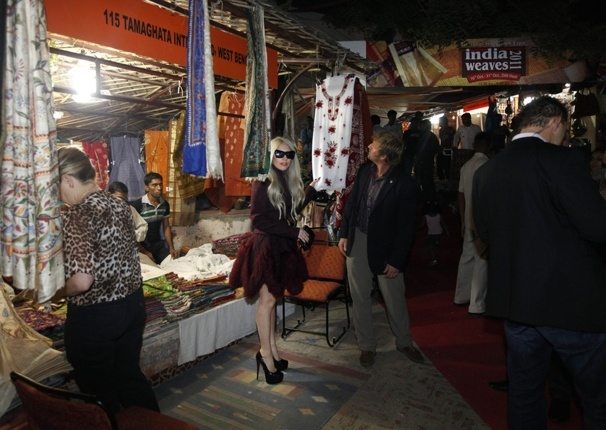 Lady Gaga stands next to a shop at the Dilli Haat handicrafts market in New Delhi, India.