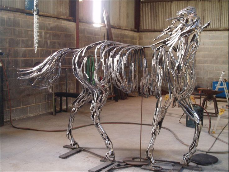 A horse sculpture still in progress, made with horseshoes - by William Wilson, via horseandman