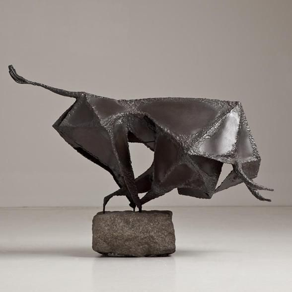 A Brutalist Metal Sculpture of a Charging Bull mid 1960s                                                                                                                                                                                 More