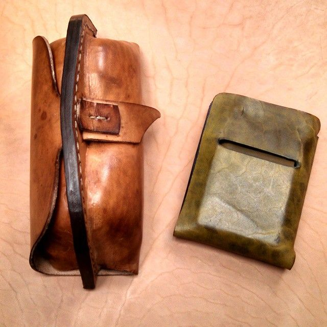#handcolored #patina #foldwallet shown in our #greenleaf #tobacco coloring. Original color was same as the underneath piece of leather. Inside of #wallet is #frenchblue purple.  A mix of #frenchinspired with #americana.  Shown next to our double #molded eyeglass case. Makes a nice combo.  #handmade #madeinusa #Minneapolis #minimalistwallet #minimaldesign #mensaccessories  #leathecase #leathergoods #horsehide #madetolast