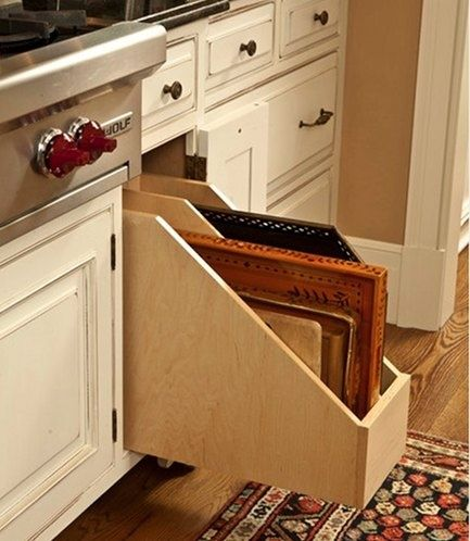 Store your cookie sheets and cutting boards in a horizontal divided tray on a slide-out! Brilliant.