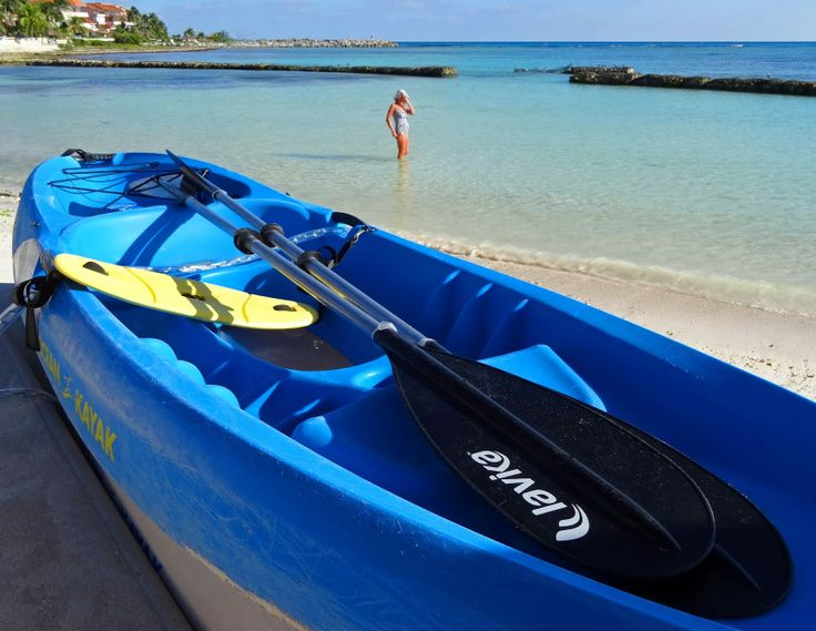 Kayaking, paddle boarding, snorkeling, and swimming are all popular pastimes on the beach in Puerto Aventuras