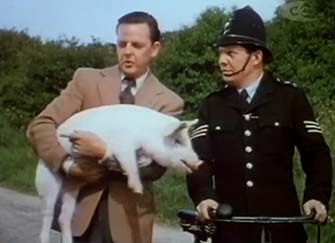 0 David Tomlinson holding a pig and Michael Brennan in made in heaven 1952