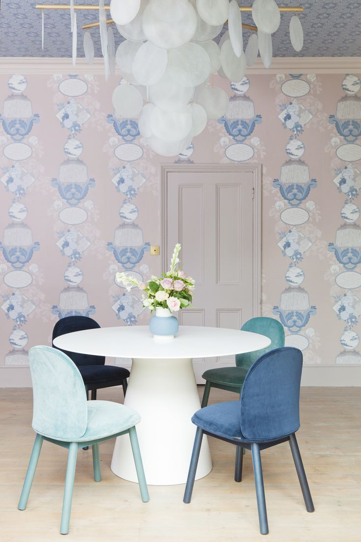 A beautiful white Corian dining table from Layer styled by the wonderful 2 Lovely Gays. Wallpaper by Graham and Brown.
