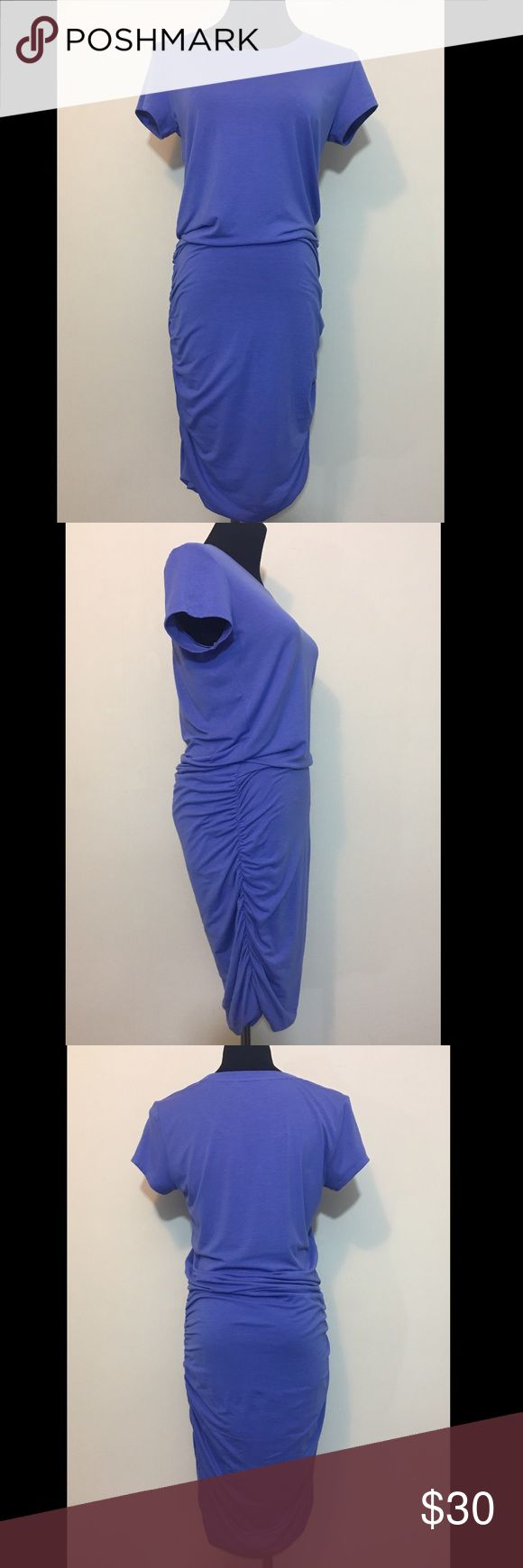"""Athleta Purple Dress Women's Tall Women's dress by Athleta. Purple. Short sleeve. Crewneck. Fold over waist and ruched skirt. Tall women's size small.  36"""" bust. Foldover waist and ruched skirt make the length of the dress adjustable. This is approximately a knee length dress.  62% polyester, 33% rayon, 5% spandex.  No rips, tears, stains, or flaws. From a smoke free home.  B015 Athleta Dresses Midi"""