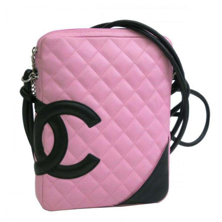 This authentic CHANEL Medium Cambon is made from pink and black quilted leather. The interior opens to a signature CC textile. Popular among CHANEL lovers everywhere this chic and stylish design features pink and black quilted leather CC logo silver-tone hardware and a long leather strap so you can wear it as a cross-body. The perfect companion for day or night. For more items like this visit https://www.swayy.com.au/