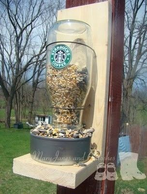 Starbucks bird feeder tutorial, using bottle, tuna can, wire and wood frame. by janette